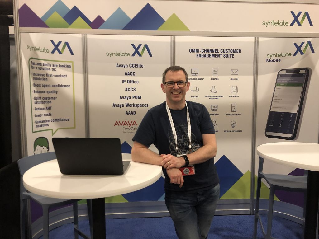 Fraser, Head of Integration at Inisoft, standing in our booth at the Avaya ENGAGE 2020 conference.